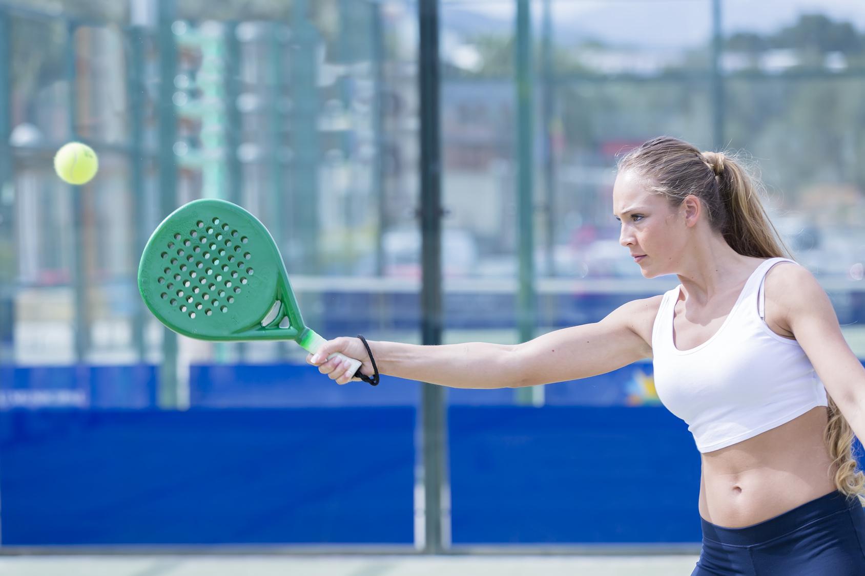 girl playing padel